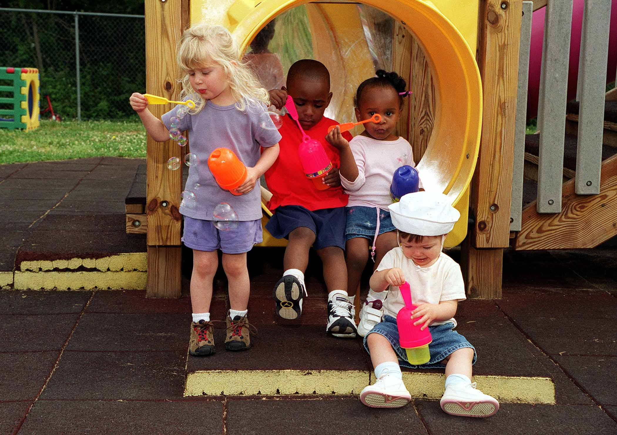 Childcare and Social Media Friends or Foes? - Children playing in the park